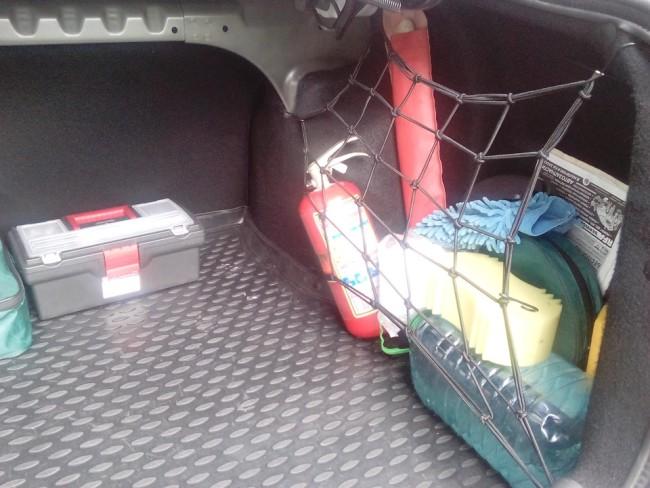 Сетка в правом кармане багажника Лада Гранта
