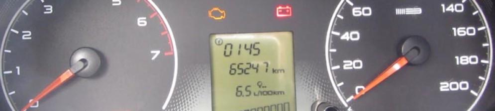Часы на панели бортового компьютера Лада Гранта