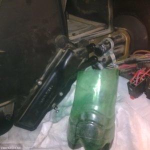 Слив остатков тосола с радиатора отопителя Шевроле Нива