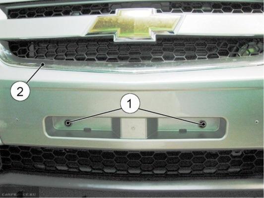 Два винта крепления бампера под номерным знаком Нива Шевроле