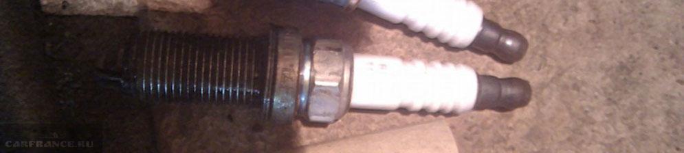 Свечи зажигания Пежо 307 демонтированные с двигателя