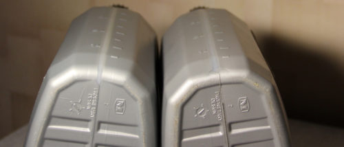 Мерные ёмкости родной и оригинальной упаковки с маслом на Форд Фокус 2