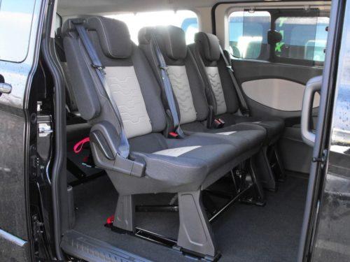 Средние сидения на салазках в пассажирском отсеке Форд Торнео Кастом 2018 года