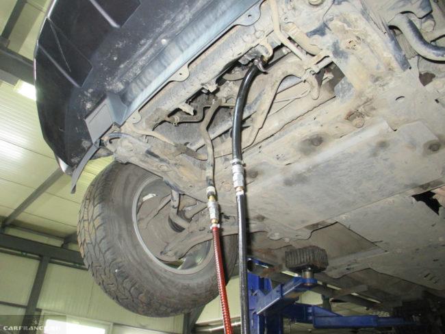 Прокачка отработанного масла АКПП в Сузуки Гранд Витара в условиях автосервиса
