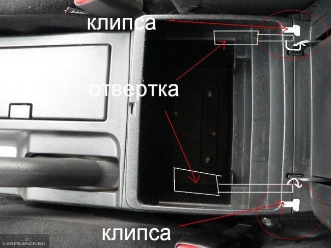 Снятие задней крышки подлокотника в Сузуки Гранд Витара для доступа к натяжителю стояночного тормоза