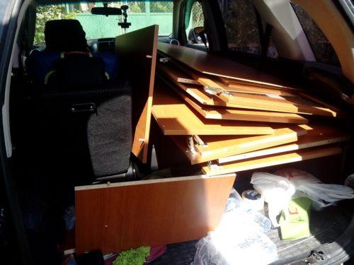 Разобранный шкаф в багажнике Сузуки Гранд Витара