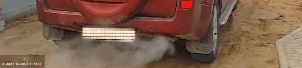 Дымит сизым дымом Сузуки Гранд Витара 2007 года выпуска 2,0 АКПП